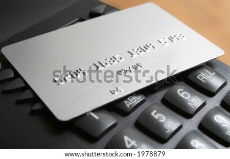 Credit Card and Telephone - stock photo