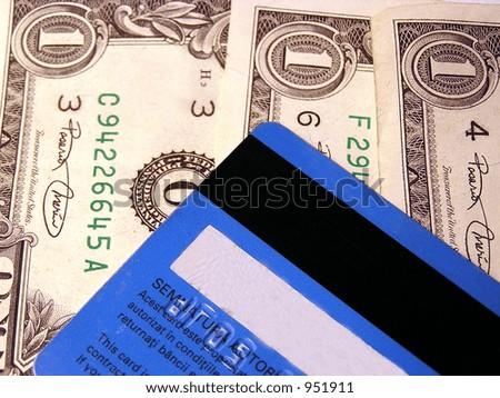 Credit card and US dollars - stock photo