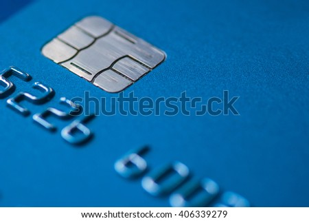 Credit Card blue with chip partial number selective focus close up macro empty space atm emv - stock photo