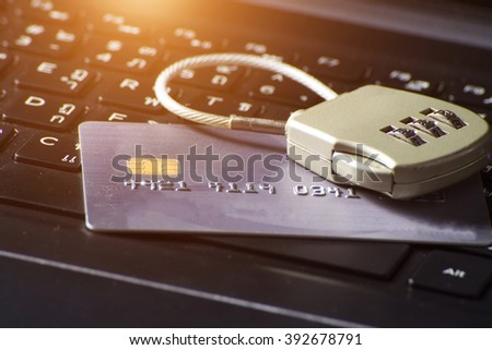 credit card data security - a security lock with a password and a credit card on computer keyboard - stock photo
