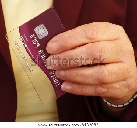 Credit card getting your attention in ladys hand - stock photo