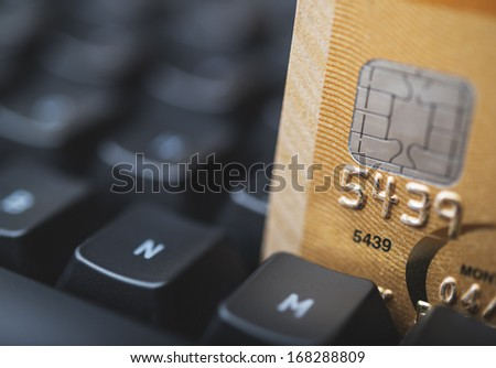 Credit card in a keyboard - stock photo
