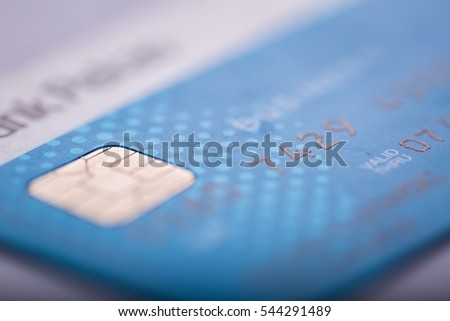 Credit card in close up. Abstract photo of bank card with shallow depth of field