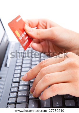 Credit card in hand for buying online - stock photo