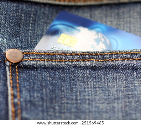 Credit card in jeans pocket - stock photo