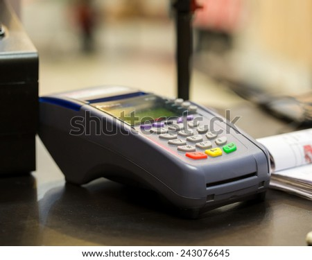 Credit Card Machine on cashier counter in the store - stock photo
