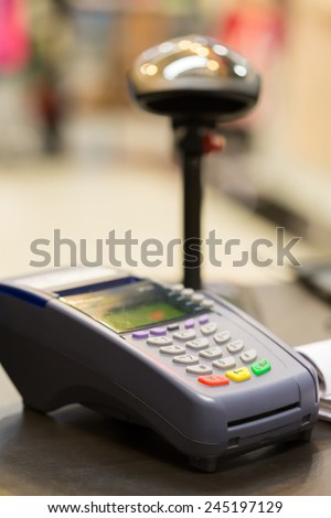 Credit Card Machine on cashier counter in the store : Selective Focus - stock photo