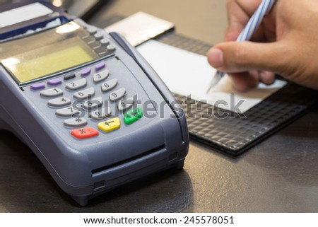 Credit Card Machine With Signing Transaction In Background : Selective Focus - stock photo
