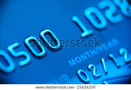 Credit card macro in blue with vignette - stock photo