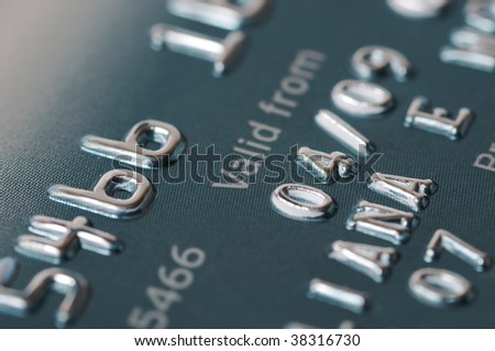 Credit card numbers shot close up showing the words Valid From and the date. - stock photo