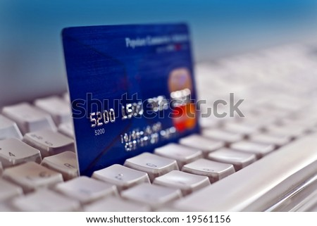 Credit card on a computer keyboard 02 - stock photo