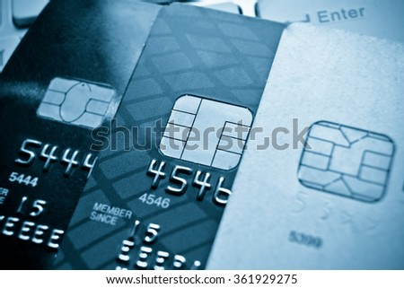 Credit card on computer keyboard / e-commerce concept - stock photo