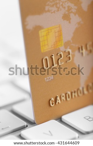 Credit card on keyboard, closeup - stock photo