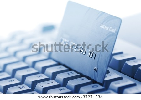 Credit card on keyboard,Closeup(toned blue). - stock photo