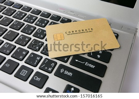 Credit card on laptop computer. - stock photo