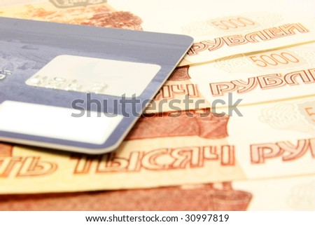 Credit card over russian money close-up - stock photo