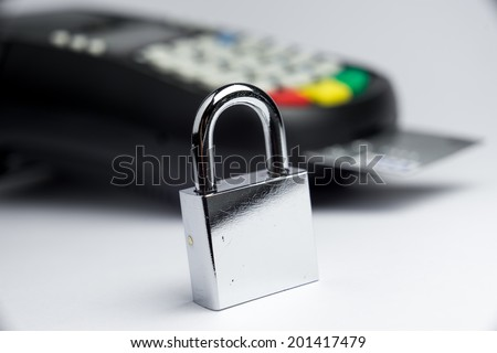 Credit Card payment security with key lock & padlock  - stock photo