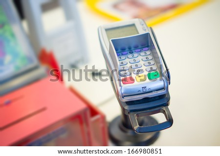 Credit card payment terminal in shop - stock photo