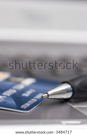 credit card, pen and computer, background - stock photo
