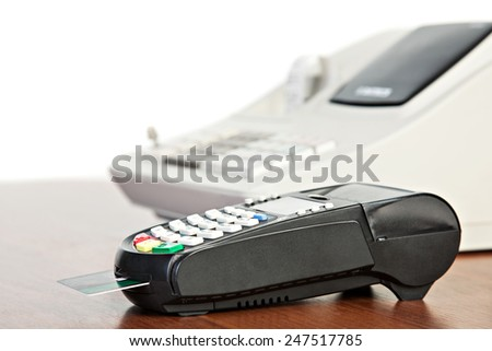 Credit Card reader and  cash register - stock photo
