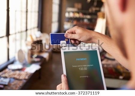 Credit Card Reading Device Attached To Digital Tablet - stock photo