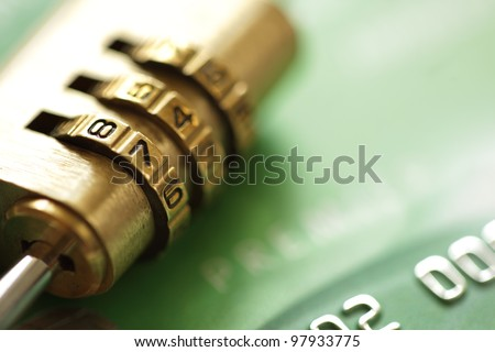 Credit card security concept with combination lock padlock - stock photo