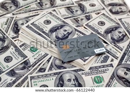 Credit card with dollars - stock photo