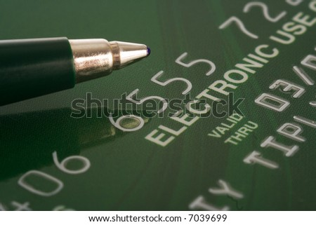 credit card with pen financial background - stock photo