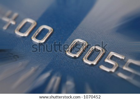 credit card with zoom effect numbers are faked - stock photo