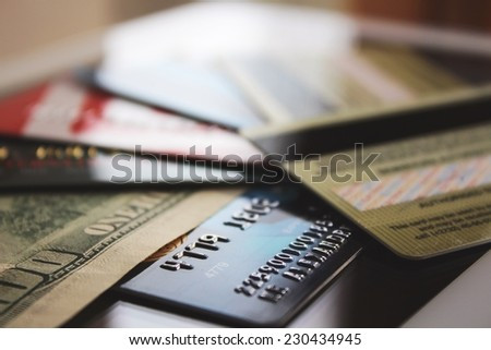 Credit cards and banknote (macro) - stock photo