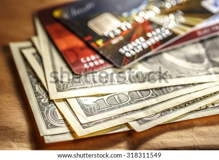 Credit cards and dollar banknotes in closeup  - stock photo