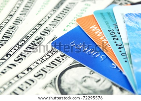 Credit cards and dollar bills - stock photo