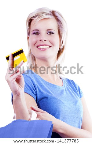 Credit cards and shopping bags holding the hand of a woman.
