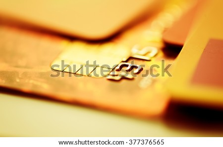 Credit cards. Golden toned. Business - stock photo