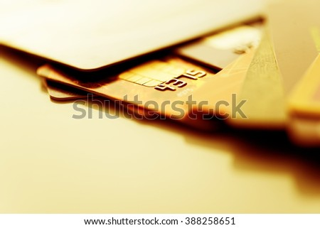 Credit cards. Golden toned. Business