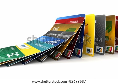 Credit cards in a row falling - credit card debt concept - stock photo