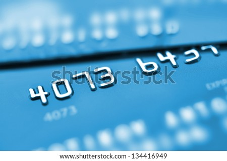 Credit cards in blue tone with shallow depth of field. - stock photo