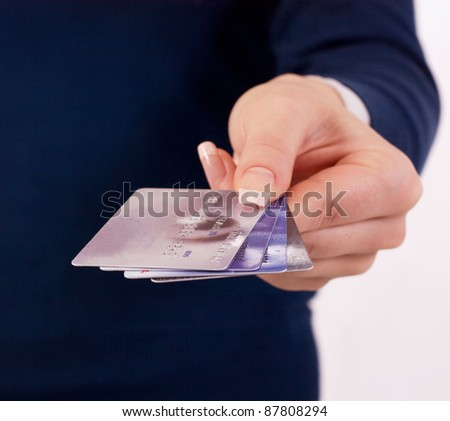 credit cards in woman's hand - stock photo