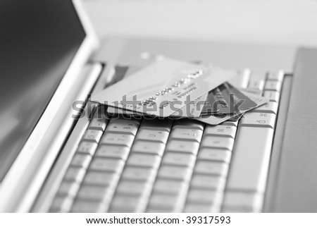 Credit cards on a laptop keyboard - stock photo