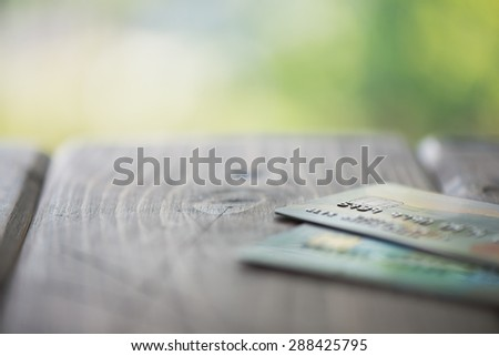 Credit cards on a wooden table up close - Split toned - stock photo