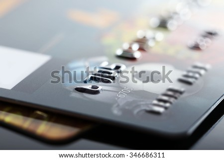 Credit cards on black background, close up - stock photo
