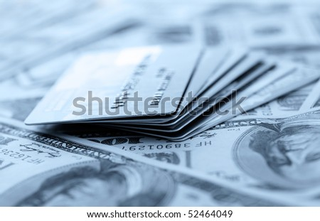 Credit cards on dollars background. Shallow DOF - stock photo