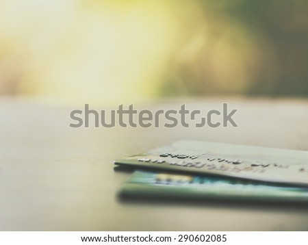 Credit cards up close with colorful bokeh - Split toned - stock photo