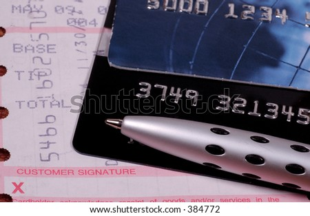 Credit Cards with a Receipt and Pen