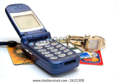 Credit cards with ladies phone & wrist watch. - stock photo