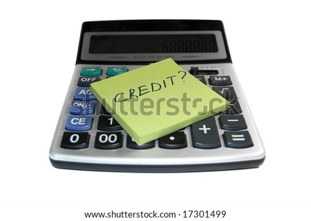 "Credit concept: note paper with word ""credit"" on calculator"
