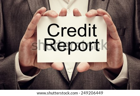 Credit Report in businessman's hands - stock photo