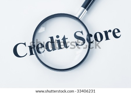 Credit Score and Magnifying Glass - stock photo