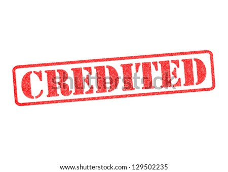 CREDITED rubber stamp over a white background. - stock photo
