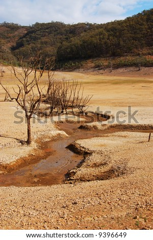 Creek in dry lake - stock photo